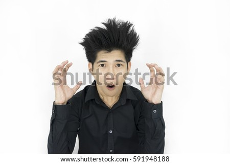 Portrait of young man with shocked facial expression on white ba