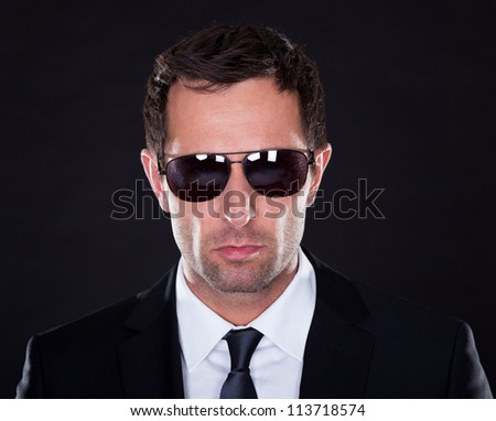 Portrait Of Young Man  With Sunglasses On Black Background - stock photo