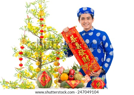Portrait of young  man with Vietnamese New Year decorations - stock photo