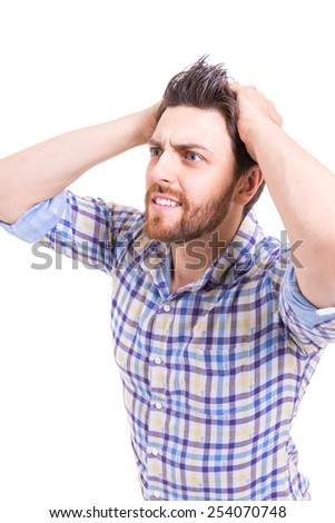 Portrait of young man worrying on white background - stock photo