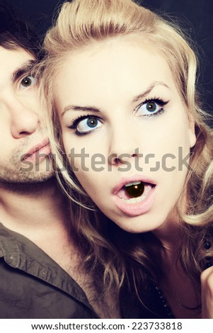 Portrait of Young men and women with chocolate candies - stock photo