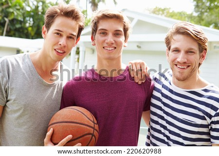 Portrait Of Young Men Playing Basketball Match