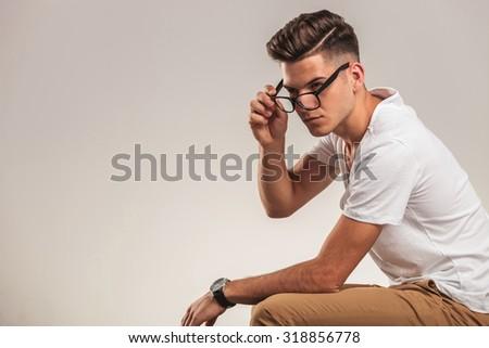 portrait of young men taking off eyewear while sitting - stock photo