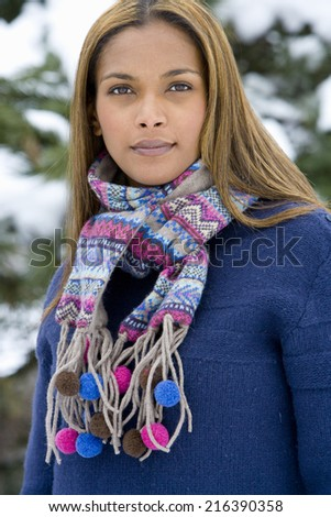 Portrait of young mixed race woman in winter clothing - stock photo