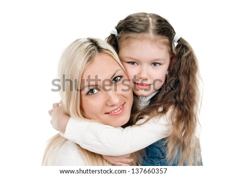 portrait of young mother and little daughter on white