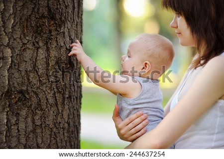 Portrait of young mother with her little son  - stock photo