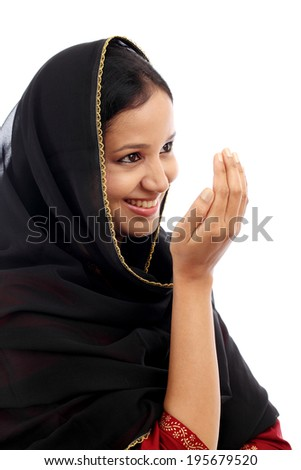 Portrait of young muslim woman against white background - stock photo