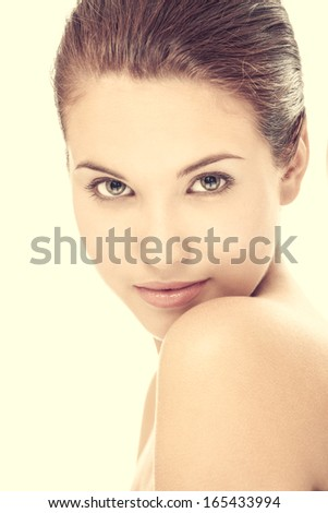 Portrait of young naturally beautiful girl isolated on a white background - stock photo
