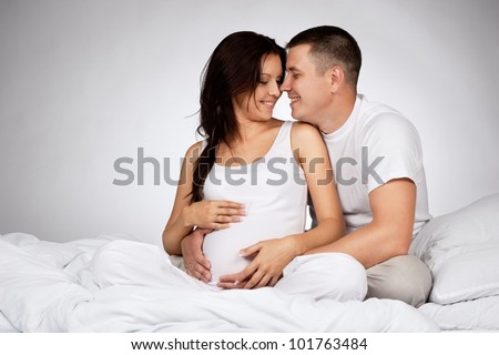 Portrait of young pair pending the kid - stock photo