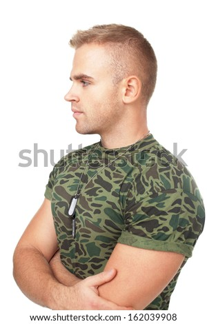 Portrait of young pensive army soldier with his arms crossed isolated on white background - stock photo