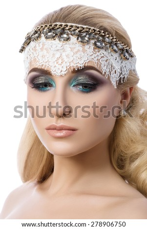 Portrait of young pensive blonde woman with fashion colourful smoky eyes make-up  - stock photo