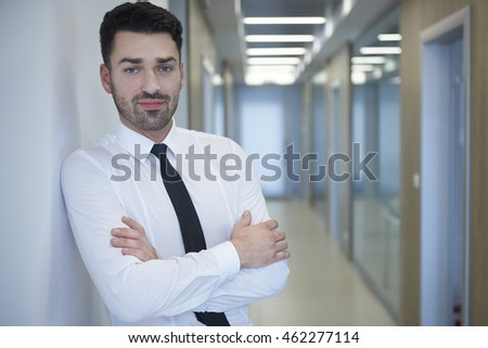 Portrait of young pensive office worker