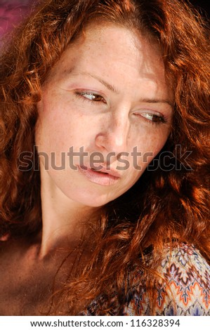 portrait of young pensive woman - stock photo