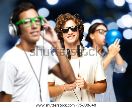 portrait of young people having a party against a blue lights