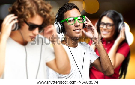 portrait of young people having a party against a golden lights - stock photo