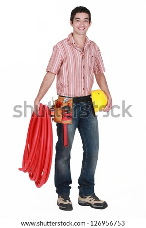 portrait of young plumber all smiles isolated on white