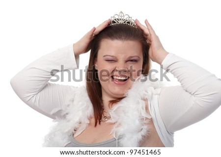 Portrait of young plump woman in tiara, winking, smiling. - stock photo