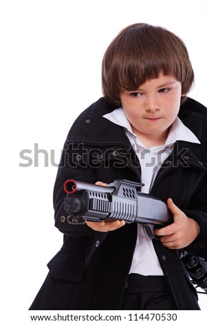 Portrait of young posing in studio with gun - stock photo