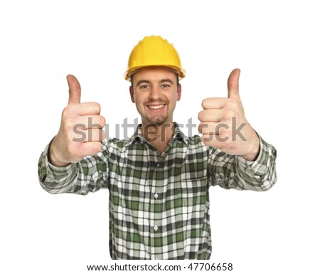 portrait of young positive manual worker thumbs up - stock photo