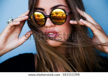 Portrait of young pretty brunette model in cool mirror stylish sunglasses, fashion style and make up. - stock photo