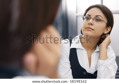 Portrait of young pretty  businesswoman in ladies room environment - stock photo