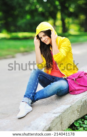 Portrait of young pretty smiling girl - stock photo