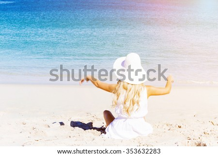 Portrait of young pretty woman cheering on sandy beach