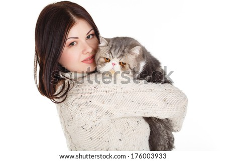 portrait of Young pretty woman holding her lovely exotic cat isolated on a white background