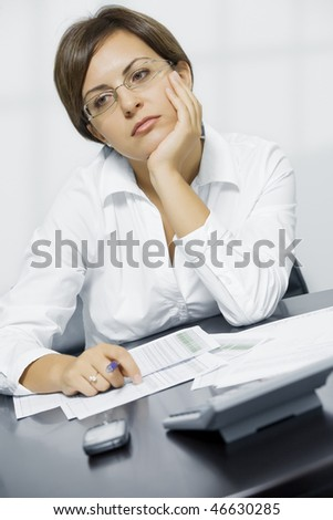 Portrait of young pretty woman in business environment - stock photo