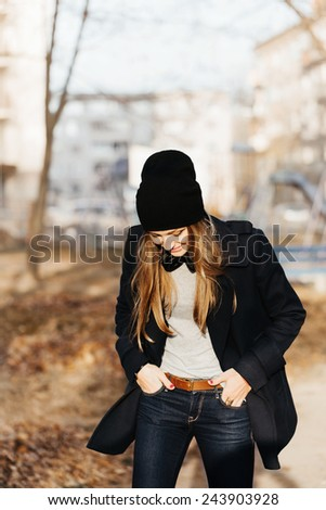 Portrait of young pretty woman walking on the street alone. Warm weather. Outdoors - stock photo