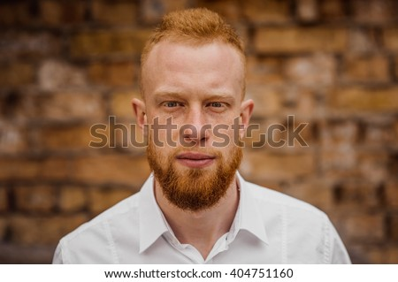 portrait of young red hair man with beard horizontal - stock photo