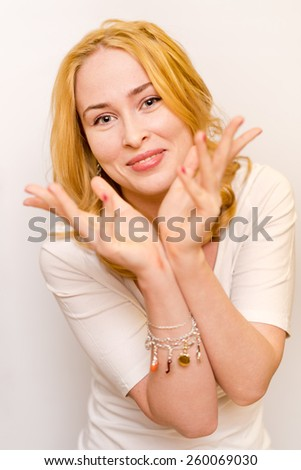 portrait of young redheaded caucasian ginger girl holding her arms near the face - stock photo