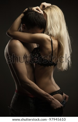 Portrait of young romantic heterosexual couple - stock photo