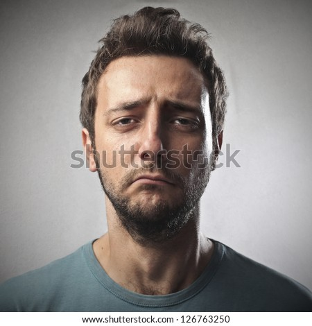 portrait of young sad man - stock photo