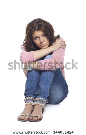 Portrait Of Young Sad Woman On White Background - stock photo