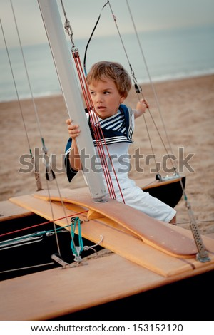 Portrait of young sailor near yacht, outdoor