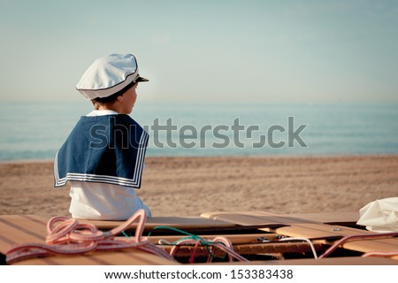 Portrait of young sailor near yacht, outdoor - stock photo