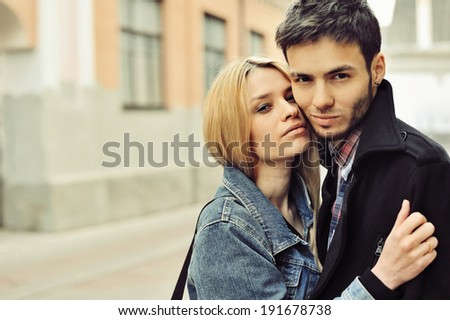 Portrait of young sensual couple outdoor  - stock photo