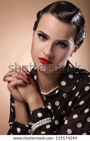 Portrait of young, serious and beautiful woman in vintage image - stock photo