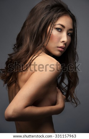 Portrait of young serious asian girl with long hair