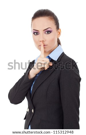 Portrait of young serious business woman keeping finger on her lips and asking to keep quiet, isolated on white background - stock photo