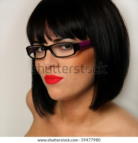 Portrait of young sexy brunette in glasses isolated on white