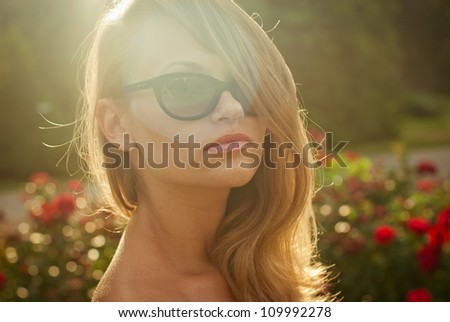 portrait of young sexy model in contour sunlight outdoor - stock photo