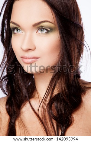 portrait of young sexy woman with green makeup