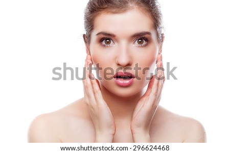 Portrait of young shocked woman. Isolated on white background - stock photo