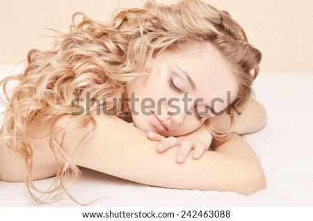 portrait of young sleeping woman - stock photo