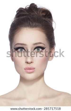 Portrait of young slim beautiful happy young woman with stylish cat eyes and surprised expression over white background - stock photo