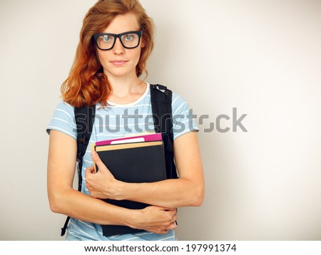 Portrait of Young smart student with books standing. - stock photo