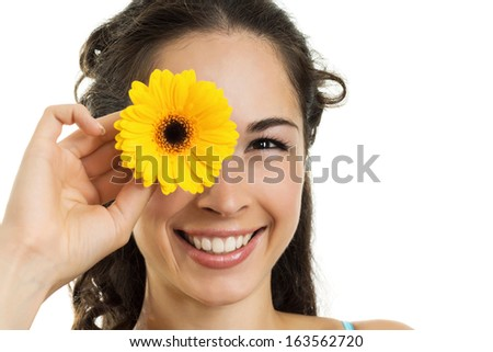 Portrait of young smiling beautiful woman with a flower on white background