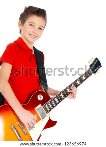 Portrait of young smiling boy with a electric guitar - isolated on white background - stock photo